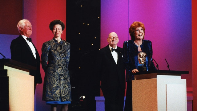 Cilla Black accepts the award on behalf of Blind Date at the British Academy Television Awards in 1995