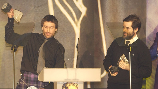 Rockstar's Leslie Benzies and Sam Houser collect the Special Award at the British Academy Games Awards in 2005.
