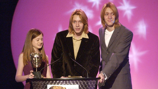 Bonnie Wright and James and Oliver Phelps collect the Feature Film prize for Harry Potter And The Prisoner Of Azkaban at the British Academy Children's Awards in 2004