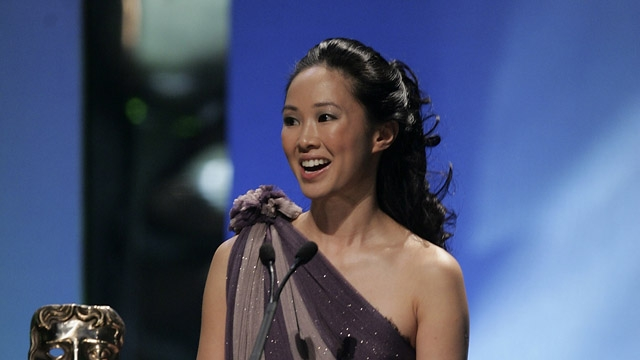 Linh Dan Pham accepts the award on behalf of Jaques Audiard for Film Not in the English Language for De Battre Mon Coeur S'est Arrete (The Beat That My Heart Beat) on stage at The Orange British Academy Film Awards in 2006.