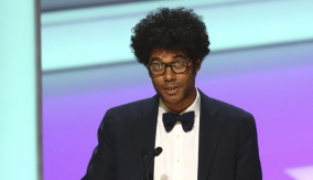 Richard Ayoade accepts the award