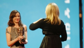 Emily Mortimer presents the award