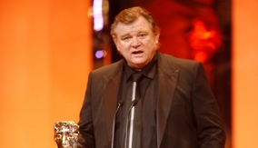 Brendan Gleeson at the podium
