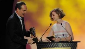 Daniel Frigo accepts the award