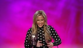 Heidi Range presents the award