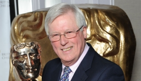 John Craven with the award