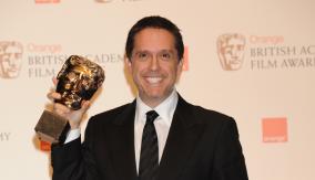 Lee Unkrich Poses with his BAFTA
