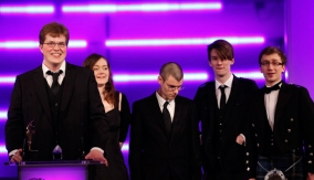 The team collect the award