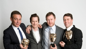 The winners and presenter