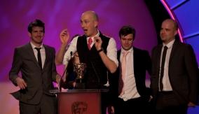 The winning team accept their award