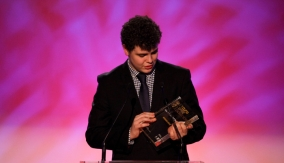 Charlie accepts the award