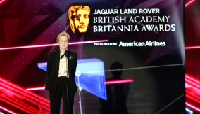 Streep accepts her award