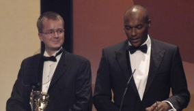 Colin Salmon (right) presents