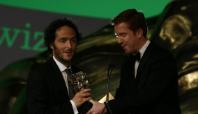Damien Lewis (right) presents