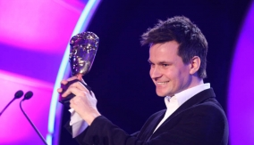 Adam Shaw accepts his award