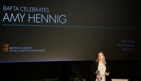 Amy Hennig accepts her award