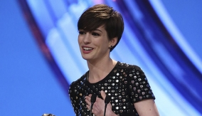 Anne Hathaway at the Podium