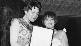 With Leslie Caron (r)