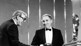 Eric Sykes presents the award