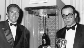 Director Guiseppe Tornatore (r)