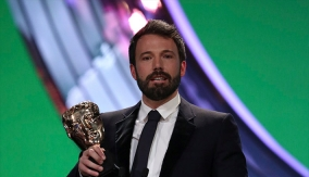 Affleck accepts the award