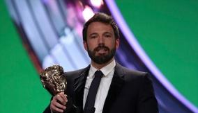 Affleck accepts the award