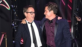 Bloom with Robert Downey Jr., who presented him with his award