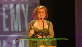 Staunton accepts the award