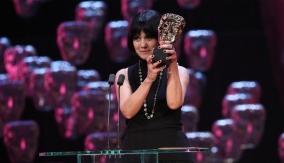 Raffaella Fantasia accept the award on behalf of Milena Canonero