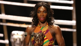 Michaela Coel at the podium