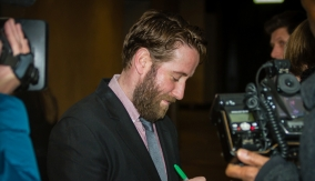 Jim Howick signs an autograph