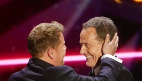 Bryan Cranston presents Corden with his award