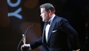 James Corden accepts the award