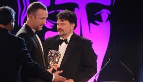 Tim Schafer presents the award