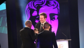 Mike Bithell presents the award
