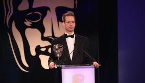 Martin Hollis presents the award