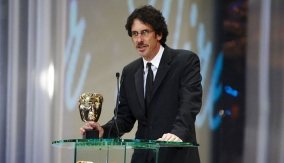 Joel Coen at the Podium