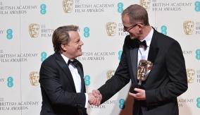 Pete Docter with Eddie Izzard, who presented him with the award