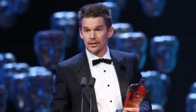 Ethan Hawke accepts the award on behalf of Richard Linklater