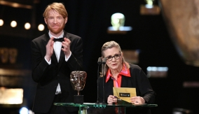 Domhnall Gleeson and Carrie Fisher present the award
