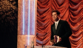 John Travolta accepts the award