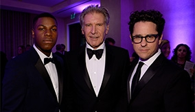 Harrison Ford with J. J. Abrams and John Boyega