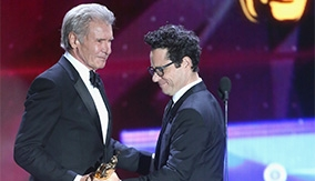 Director J. J. Abrams presents Ford with his award
