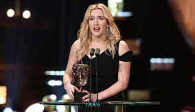 Kate Winslet accepts her third BAFTA