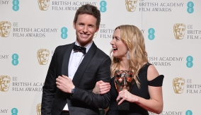Kate Winslet with Eddie Redmayne in the press room