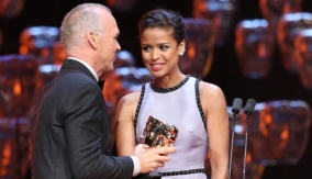 Gugu Mbatha-Raw presents the award