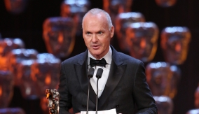 Michael Keaton accepts the award on behalf of Emmanuel Lubezki