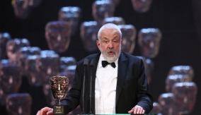 Mike Leigh at the podium
