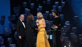 Léa Seydoux and Monica Bellucci present the award