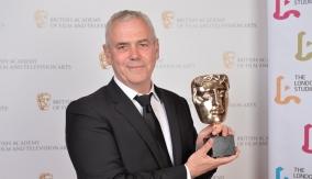 Paul McNamara with his award